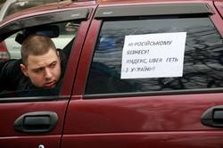 Львівські таксисти паралізували місто й вимагали припинити діяльність Uberа (ФОТО)